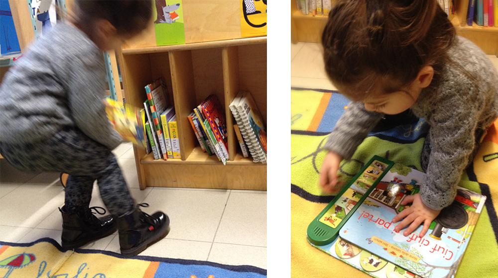 bimba in biblioteca che scegli i libri e legge