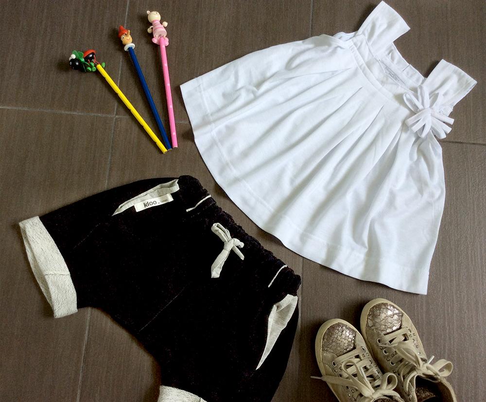 outfit bambina ritorno a scuola con bermuda in cotone organico unisex top in cotone bon ton sneakers e matite colorate