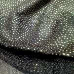 tessuto nero pois rilievo oro