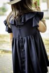 dettaglio abito bambina pepito by cous spagna con rouche e bottoncini